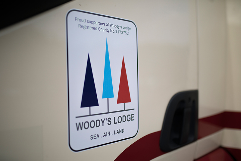 Woody's Lodge logo on Masons Removals Cardiff van